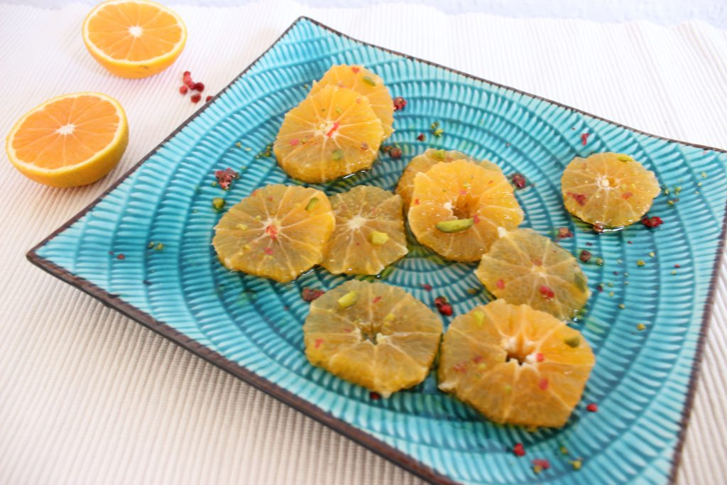 Mandarinen-Carpaccio mit Granatapfeldressing und Pistazienkrokant